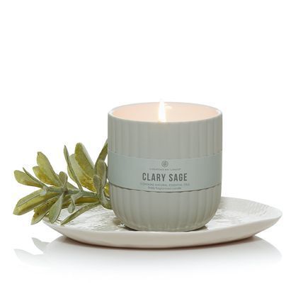 Clary Sage candle on saucer